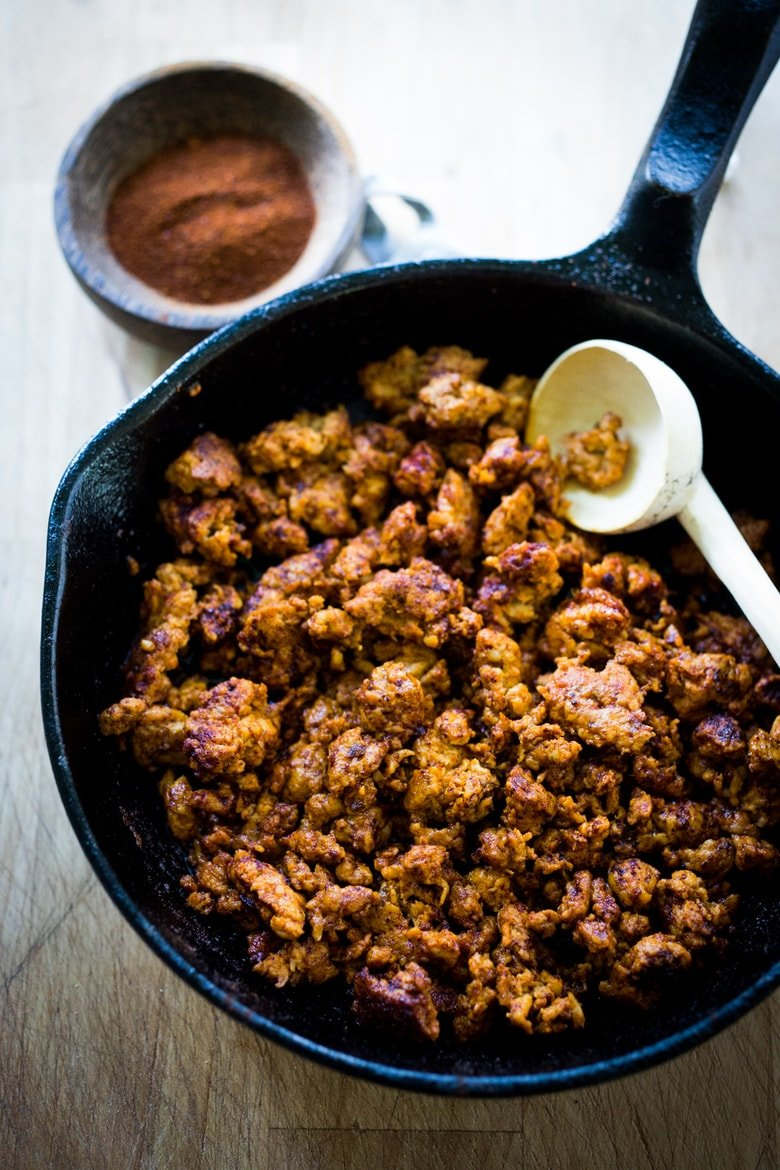 Here's a  healthy, lightened-up recipe for Mexican Chorizo, a smoky spicy and flavorful Mexican style sausage using ground turkey or ground chicken. A delicious addition to breakfast bowls, tacos, scrambles & burritos! Can be made in 20 minutes. Low-carb and GF!  #chorizorecipe #chorizo #turkeychorizo #chickenchorizo #keto #paleo #gluten-free
