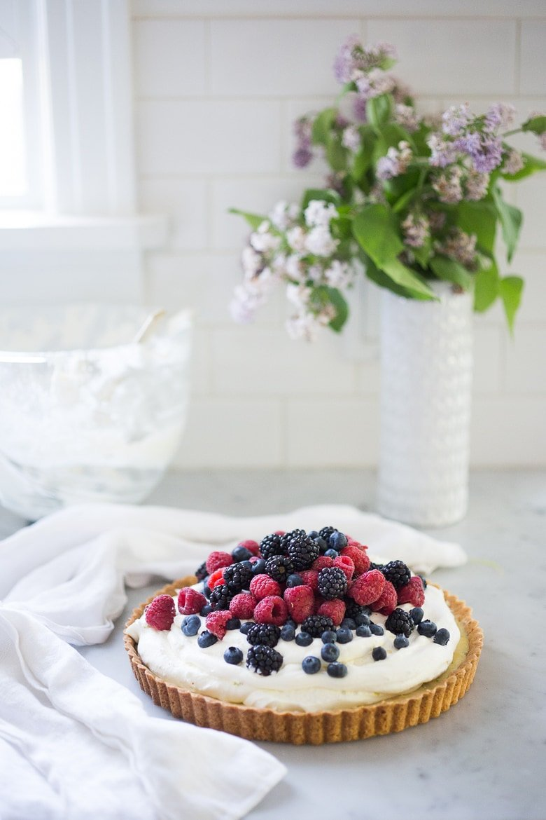 Summer Berry Tart with Shortbread Crust. A simple delicious tart recipe featuring fresh, juicy summer berries, over a lemony filling and a buttery shortbread curst. Easy, delicious! #berrytart #tart #raspberrytart #berries #freshberries #summerdessert #dessert #blackberries