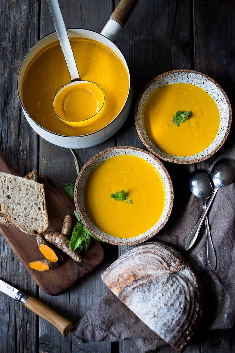 20 Mouthwatering VEGETARIAN Soups for FALL! ||Creamy Carrot Turmeric Soup with Coconut Milk and ginger. Fresh turmeric and mint gives this soup its exotic flavor. Vegan. | www.feastingathome.com