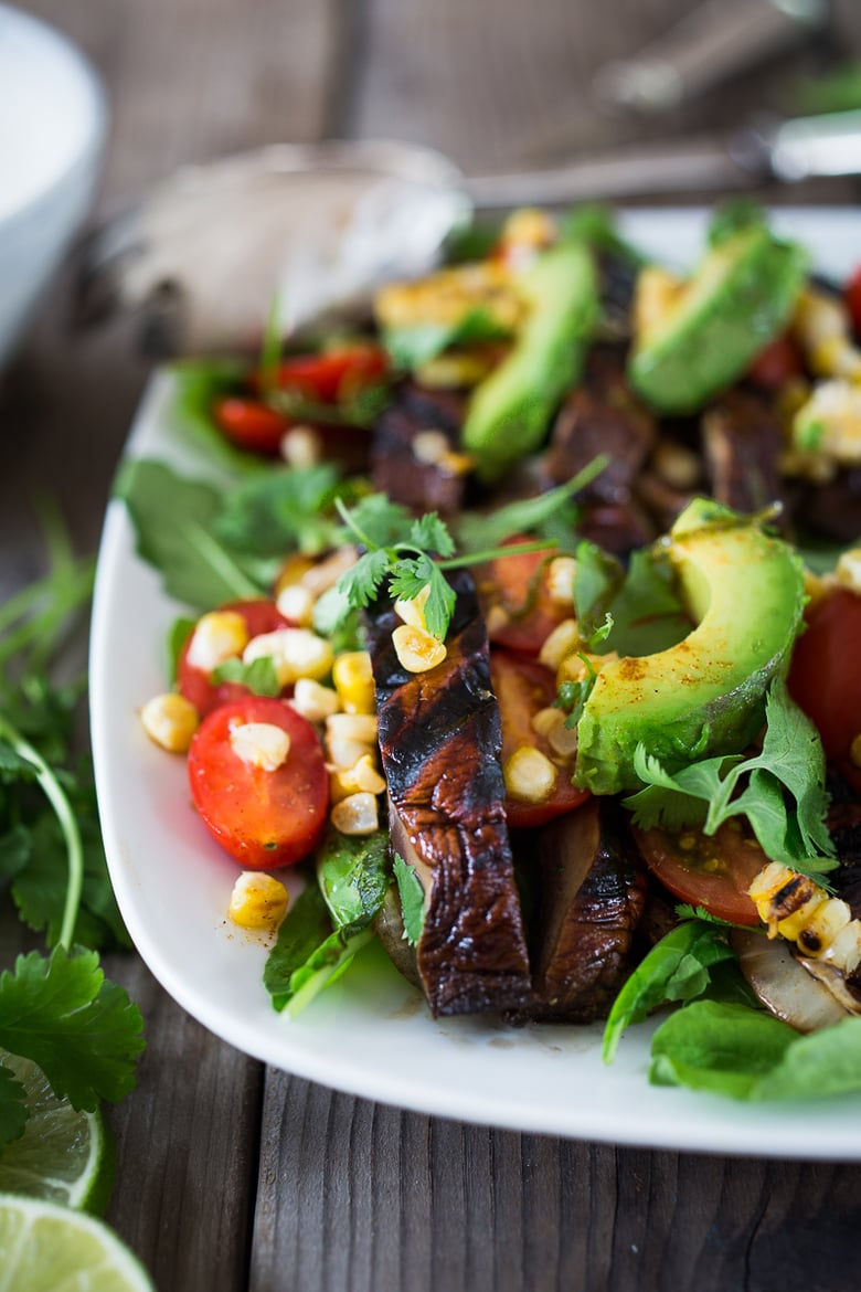 20 Summer Dinners for Hot Days! This Grilled Portobello Salad with Avocado, Tomatoes, Corn and a Smoky Lime Dressing  is vegan and low in carbs. A delicious summer salad for grilling weather!