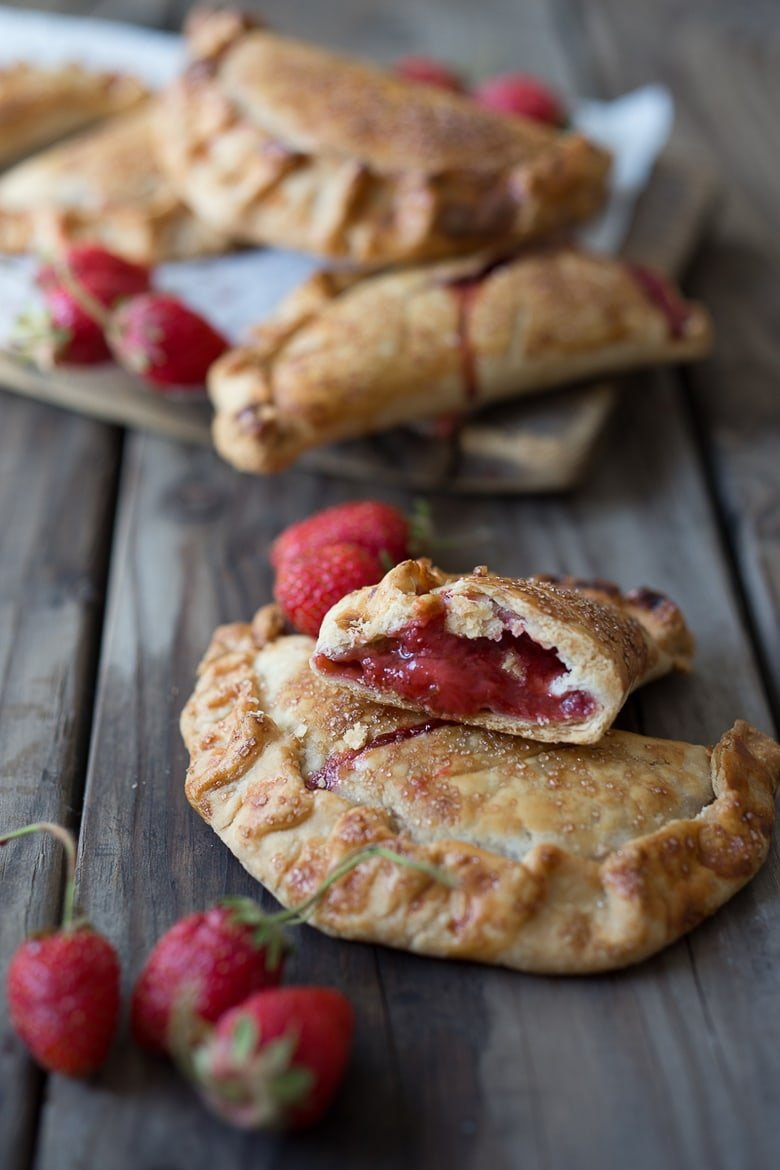 "A simple delicious recipe for Strawberry Turnovers or ""Hand Pies"" , sweetened with maple syrup! #turnovers #turnoverrecipe #handpies #strawberryrecipes www.feastingathome.com"