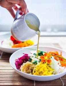 Vegan Sunshine bowl with raw summer roots and Creamy SunflowerSeed Tahini Sauce | www.feastingathome.com