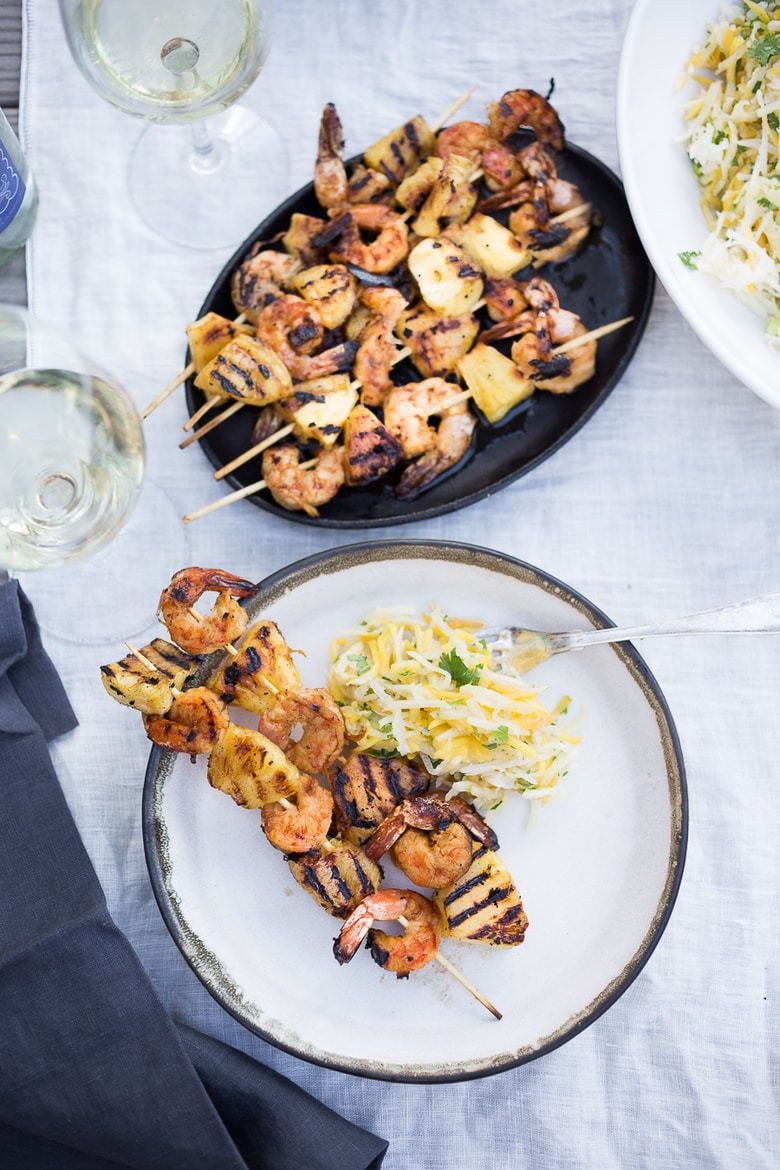 Shrimp and Pineapple Skewers with the most flavorful Chipotle Marinade. Sweet, tangy, smoky with a little spice- a delicious combination of flavors! Served over Jicama Mango Slaw.