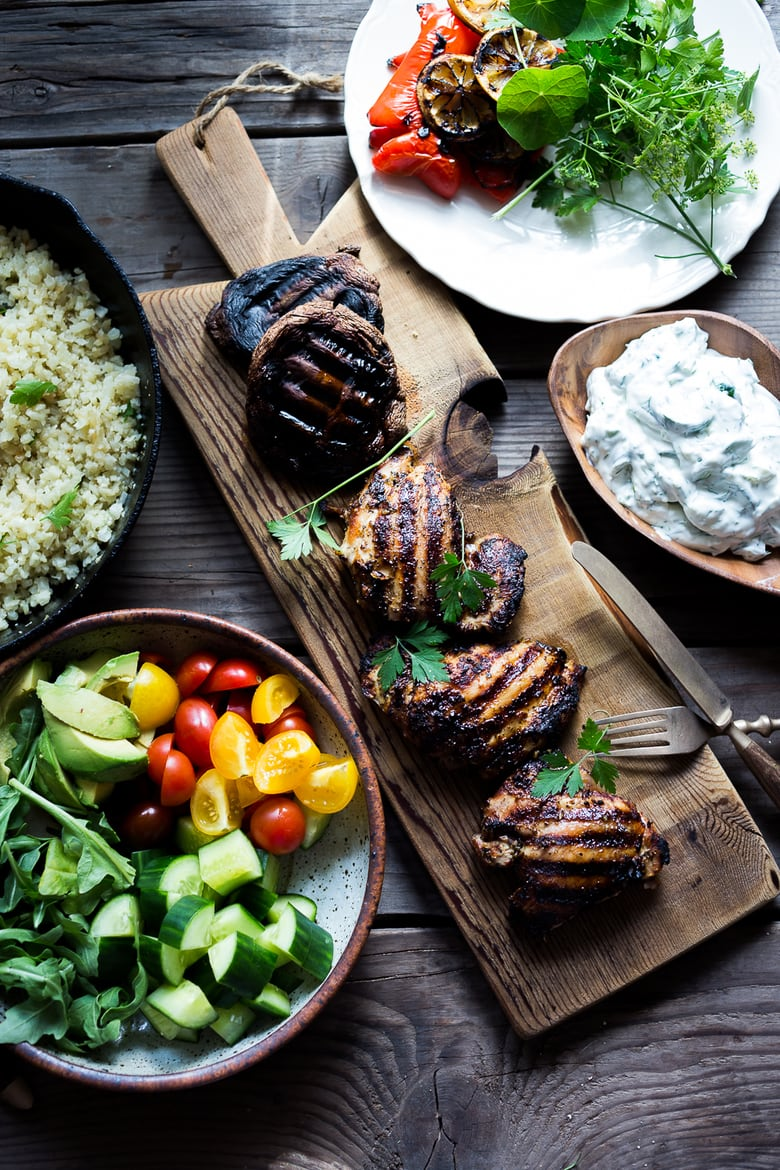 A simple tasty recipe for Grilled Greek Souvlaki Bowl with Cauliflower Rice, flavorful Cucumber Yogurt Sauce and fresh summer vegetables. This can be made with Grilled Chicken or Grilled Portobellos! + 15 DELICIOUS SUMMER GRILLING RECIPES | www.feastingathome.com