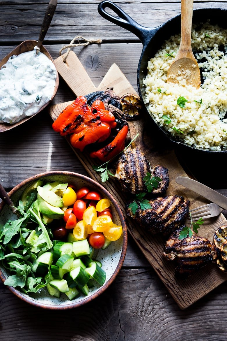 A simple tasty recipe for Grilled Greek Souvlaki Bowl with Cauliflower Rice, flavorful Cucumber Yogurt Sauce and fresh summer vegetables. This can be made with Grilled Chicken or Grilled Portobellos! | www.feastingathome.com