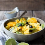 Exotic Turmeric Fruit Salad with fresh grated turmeric root, orange and lime zest and your favorite fruits, topped w/ toasted coconut flakes. Sugar free. | www.feastingathome.com