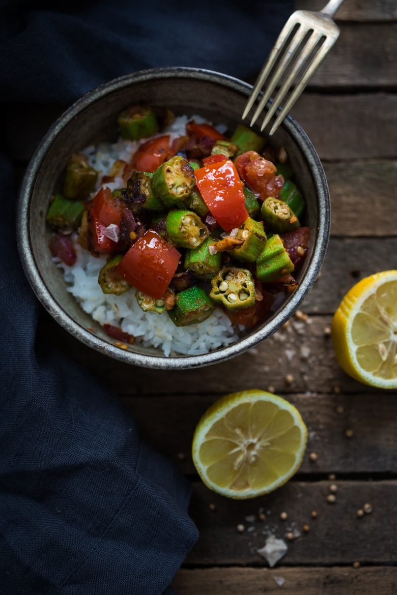 Egyptian Okra over Rice- A simple delicious vegan meal made with fresh okra, tomatoes and flavorful Middle Eastern Spices | www.feastingathome.com