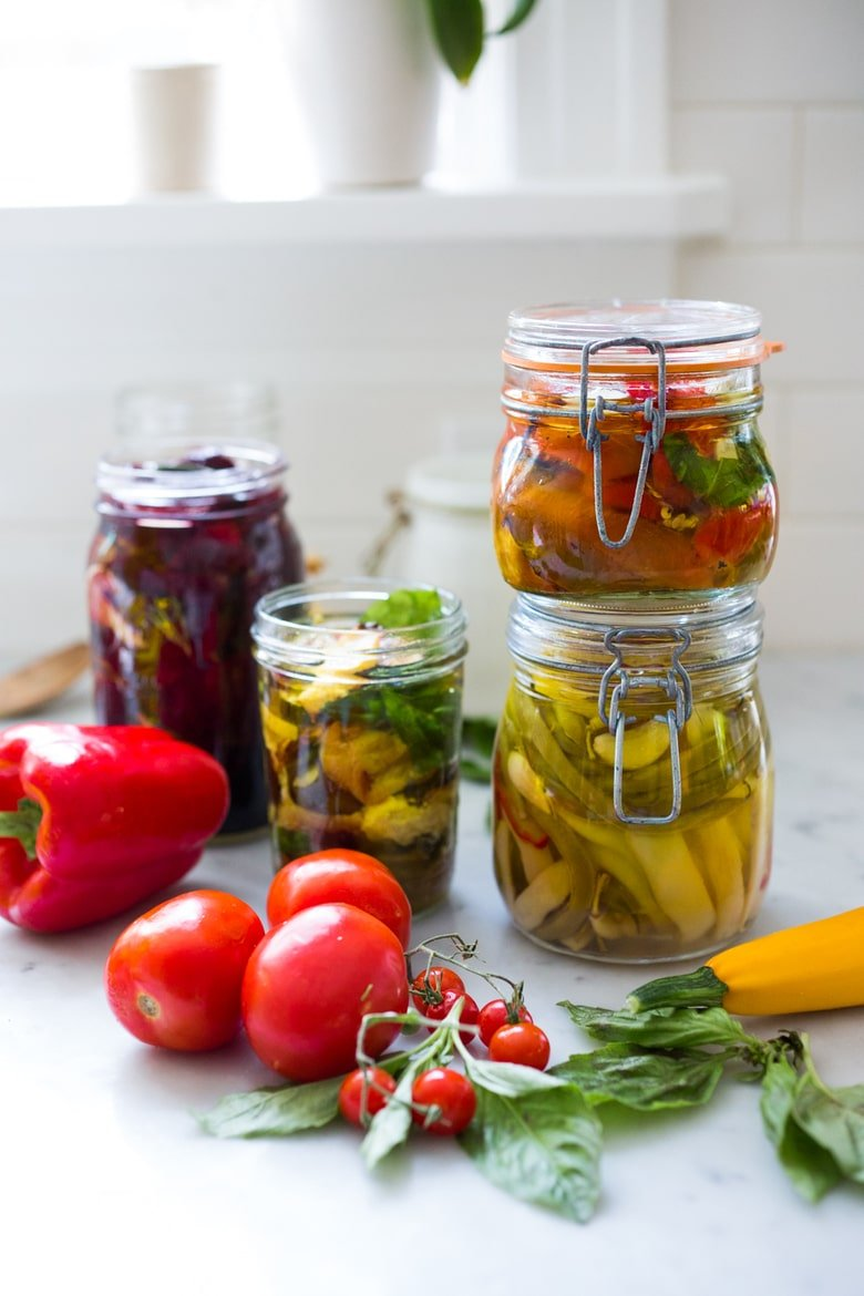 Quick Marinated Veggies! Extend summer's bounty by Preserving Veggies in Olive Oil- serve with Cheese or Charcuterie boards and Mezze Platters. Delicious, quick & simple! | www.feastingathome.com