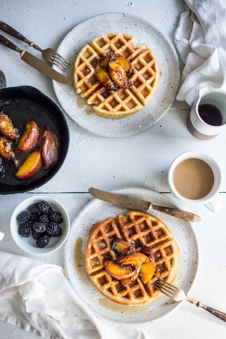 Crisp and light, Sourdough Waffles are delicious and SO simple to make using your extra starter. Top w/ Maple-glazed peaches or stone fruit.  www.feastingathome.com