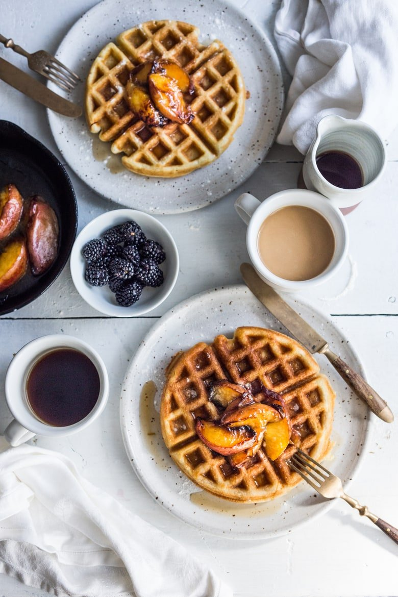 Crisp and light, Sourdough Waffles are delicious and SO simple to make using your extra starter. Top w/ Maple-glazed peaches or stone fruit.| www.feastingathome.com