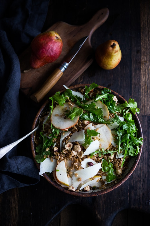 Toasted Farro with Pear, Hazelnut, Arugula and Romano- a simple vegetarian main or hearty fall salad. | www.feastingathome.com