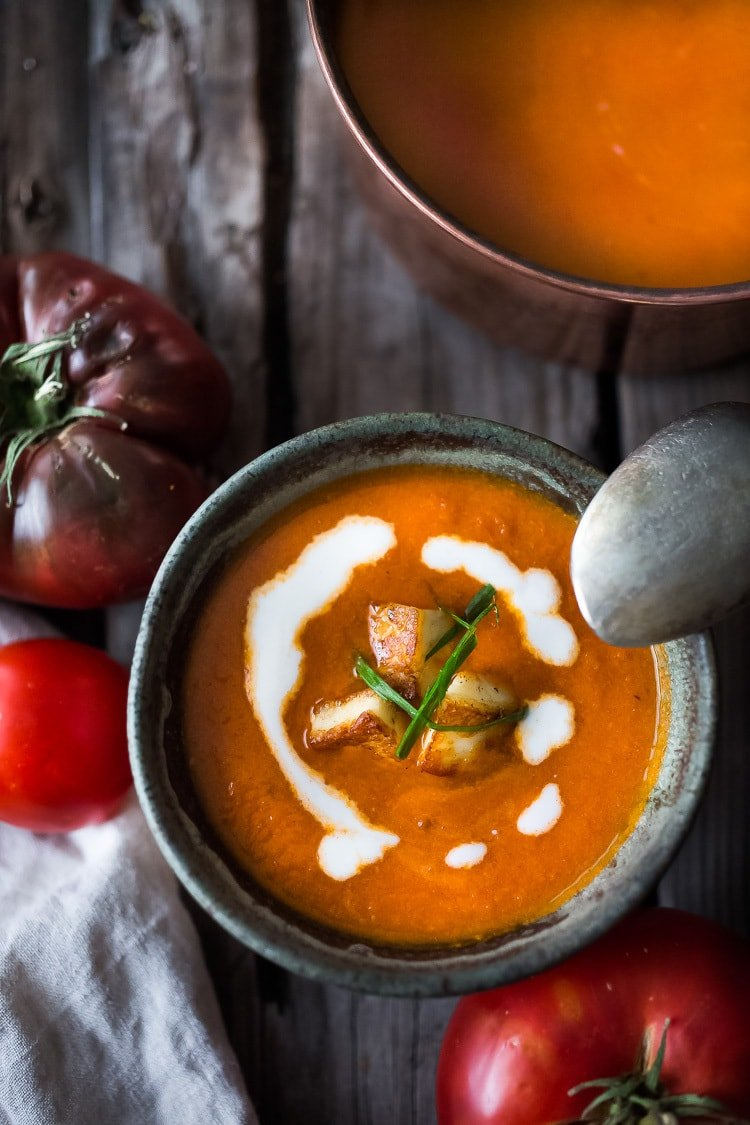 20 Mouthwatering VEGETARIAN Soups! || Roasted Tomato Soup with fresh roasted heirloom tomatoes, topped with crispy Haloumi Croutons. A healthy bowl of velvety goodness! | www.feastingathome.com | #tomatosoup #soup #vegetarian #haloumi #roastedtomatoes #roastedtomatosoup