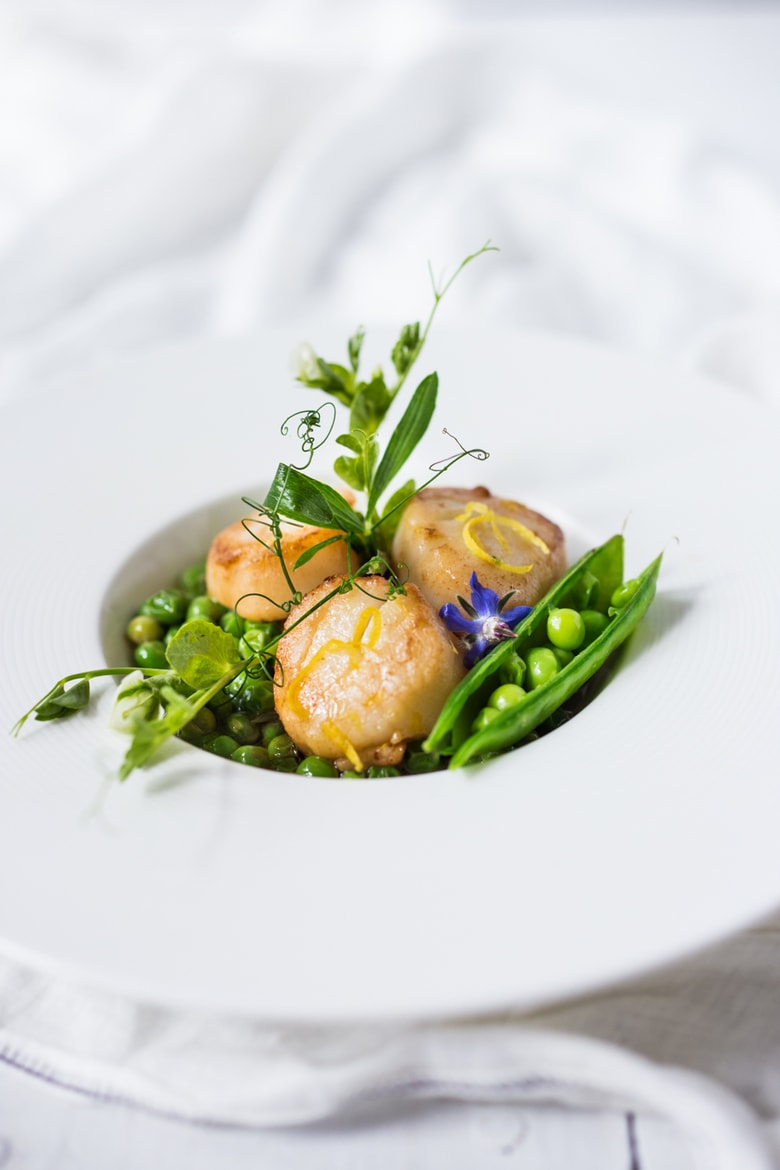 Seared Scallops with Spring peas, tarragon and truffle oil- a light and elegant meal, perfect for entertaining or special occasions. | www.feastingathome.com
