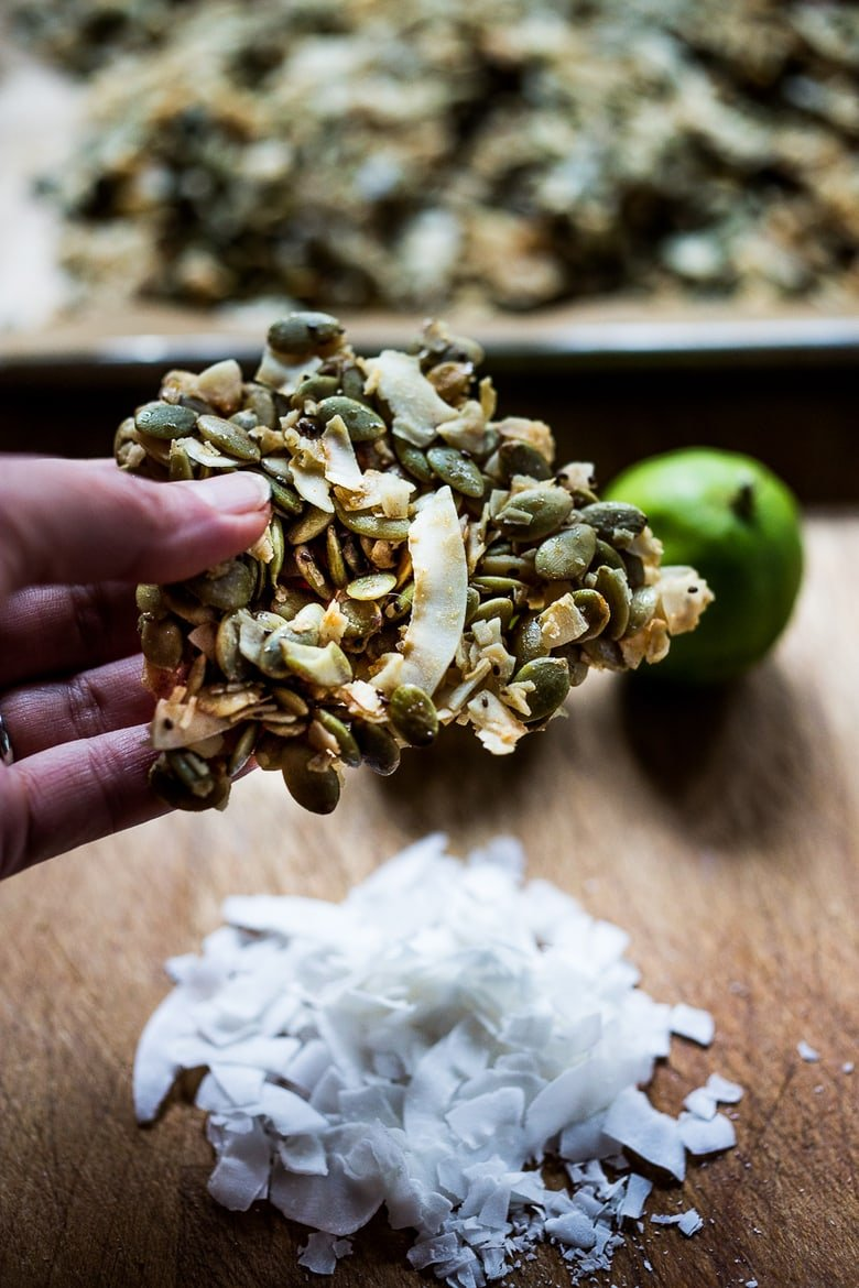 A simple recipe for Coconut Pumpkin Seed Snacks infused with lime and honey. Easy, delicious! Vegan and gluten free!   www.feastingathome.com