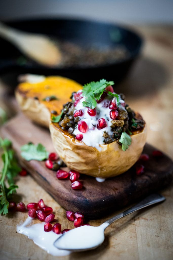 Stuffed Butternut with Persian Lentils, dried fruit, yogurt, pomegranate and cilantro. Vegetarian, gluten free. | www.feastingathome.com