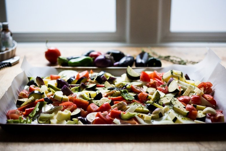 Baked Sheet-Pan Ratatouille is easy, healthy and vegan! Bake a big batch on Sunday then serve it during the busy workweek over pasta, polenta or even toast! #vegan #ratatouille #baked #easy #paleo | www.feastingathome.com
