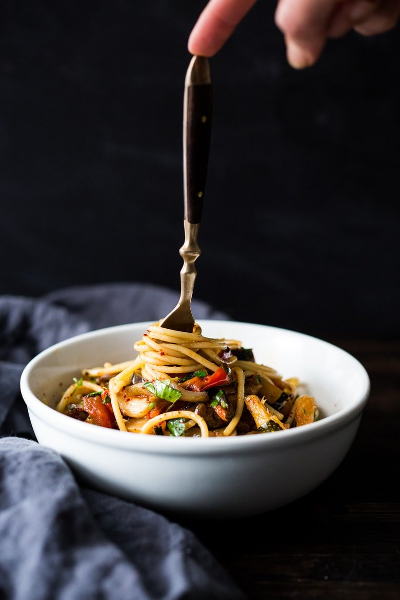 A simple vegan pasta recipe -Roasted Ratatouille Pasta- loaded up with end of summer veggies that are roasted in the oven. #ratatouille #sheetpan #veganpasta #healthypasta | www.feastingathome.com