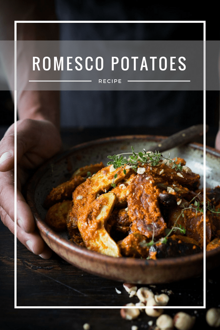 Roasted Fingerling Potatoes with Romesco Sauce, made w/ simple pantry ingredients you probably already have! A simple vegan side dish perfect for weeknight dinners or the holiday table! | www.feastingathome.com #romesco #roastedpotatoes #veganpotatoes #veganside #romescopotatoes #thanksgivingsidedish #sidedish #vegetarain