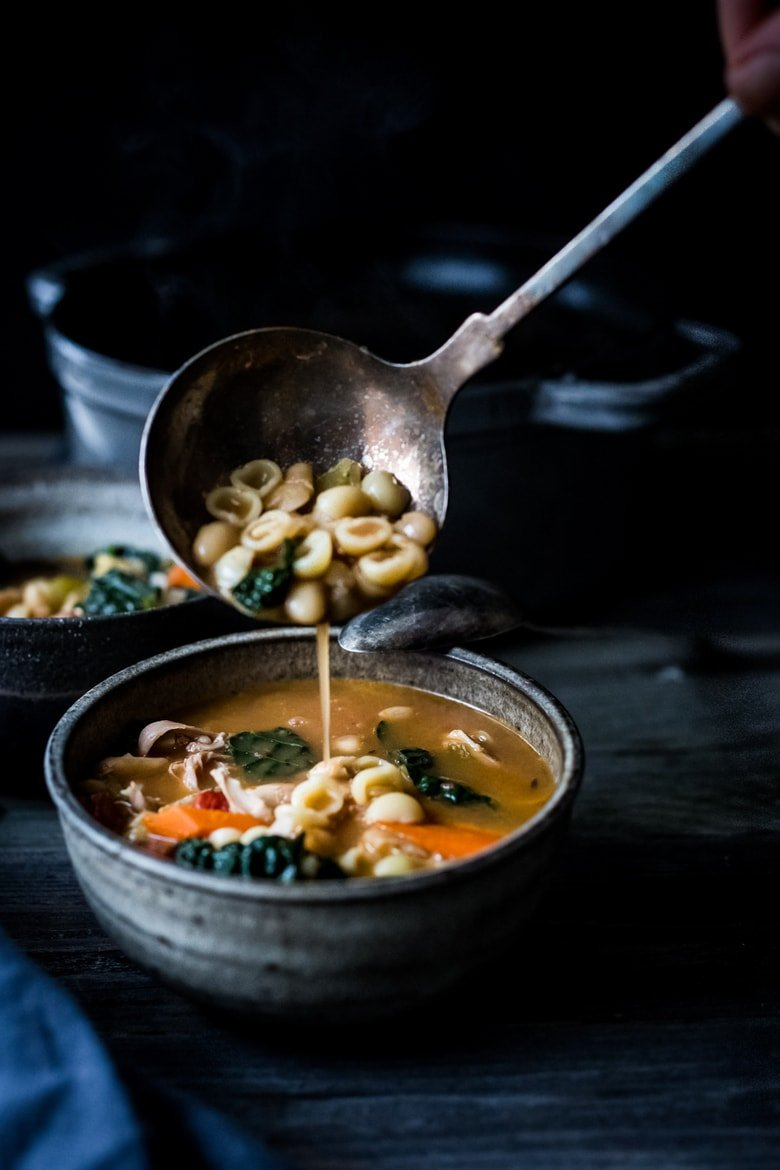Turkey Minestrone Soup- A cozy soup to make the day after Thanksgiving using leftover turkey and simple pantry ingredients.   www.feasingathome.com