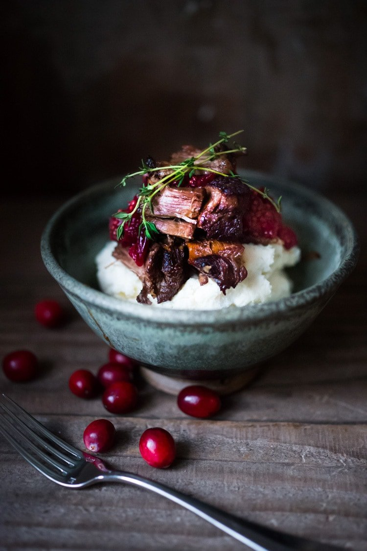 Cranberry Pot Roast - a simple festive recipe for beef roast, baked with fresh cranberries and roasted in the oven- tender, juicy and flavorful! Perfect for the holidays or a simple Sunday super.  #potroast #cranberries #cranberryrecipes #beef #beefroast #holidayrecipes #easy