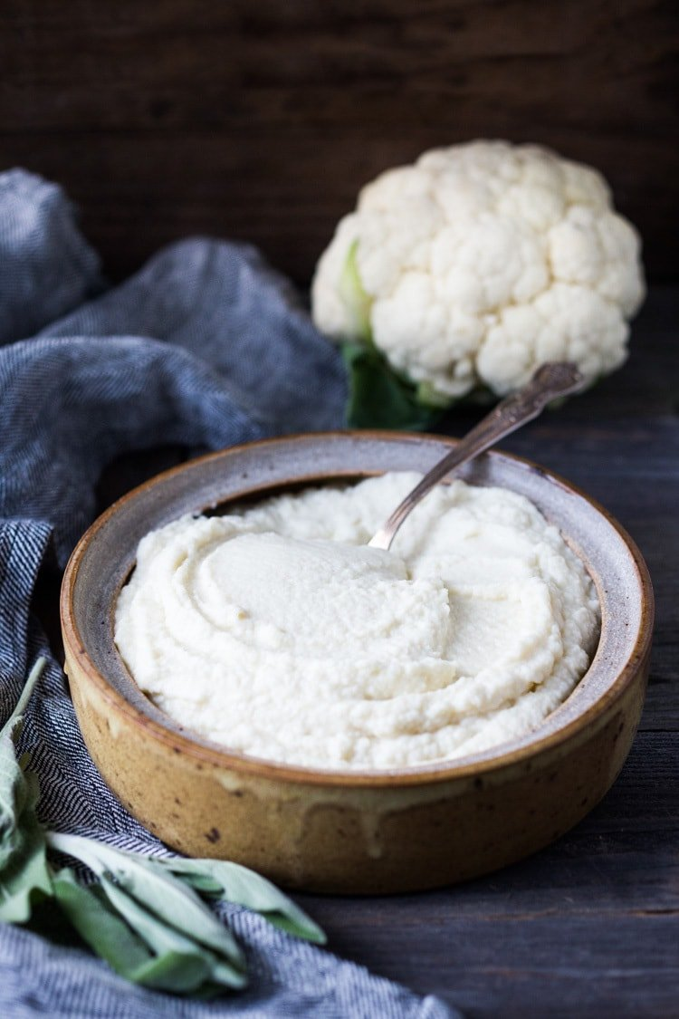 Mashed Cauliflower with Roasted Garlic, an easy delicious alternative to mashed potatoes, keto friendly, low carb, healthy and full of amazing flavor! The perfect side dish to any occasion! Vegan adaptable and gluten-free! #feastingathome #mashedcauliflower #cauliflowermashedpotatoes #cauliflowermash #vegan