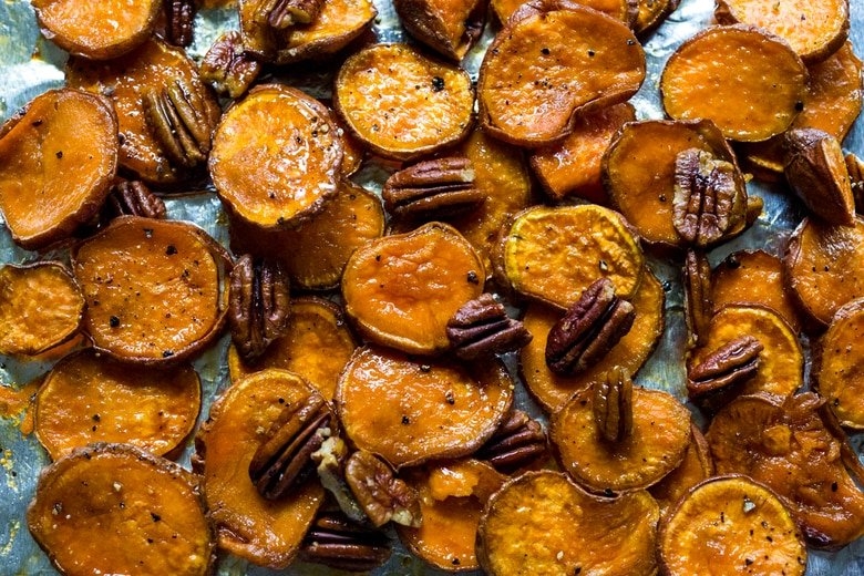 Maple Roasted Yams with Pecans- a simple vegan and gluten free side dish that can be made in 30 minutes | www.feastingathome.com
