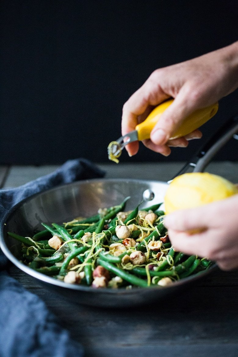 Truffled Green beans with Hazelnuts, Shallots and Lemon Zest - a quick, delicious and elegant side dish, perfect for the holidays. | www.feastingathome.com