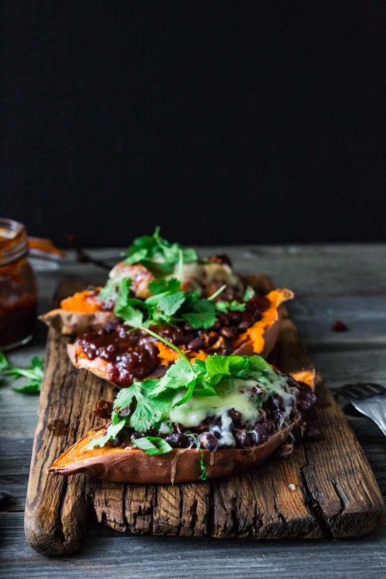 Baked Sweet Potatoes with BBQ Chicken ( or Black beans) or both! Perfect for mixed households whohave meat-lovers, vegetarians, vegans, and gluten-free folks all living under the same roof.Customizable and adaptable!| #bakedsweetpotato | www.feastingathome.com