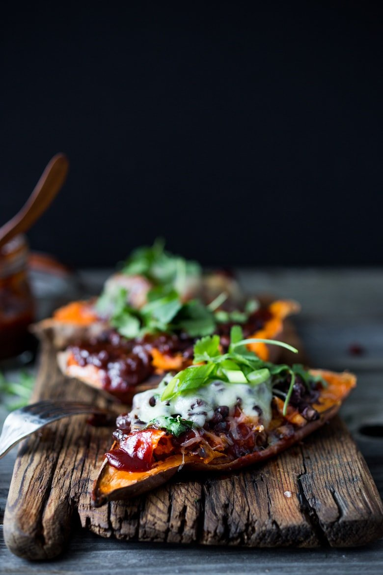 Baked Sweet Potatoes with BBQ Chicken ( or Black beans) or both! Perfect for mixed households whohave meat-lovers, vegetarians, vegans, and gluten-free folks all living under the same roof.Customizable and adaptable!| #bbqsweetpotato | www.feastingathome.com