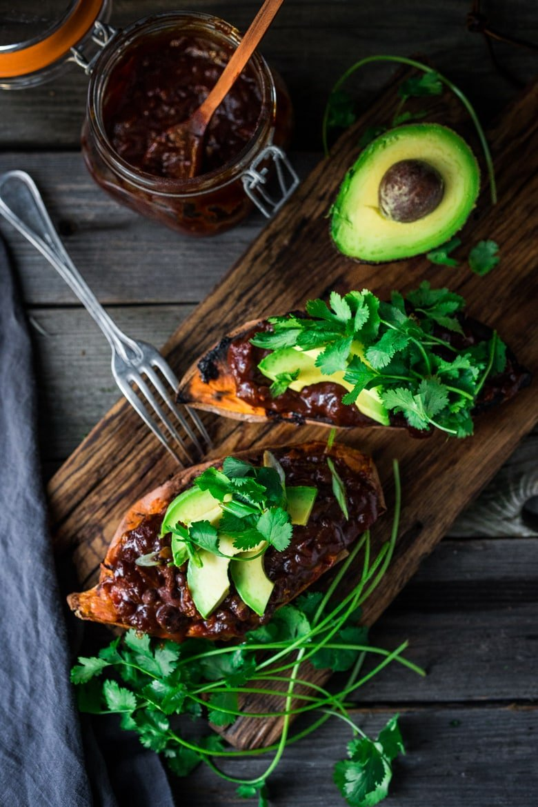 Baked Sweet Potatoes with BBQ Chicken ( or Black beans) or both! Perfect for mixed households who have meat-lovers, vegetarians, vegans, and gluten-free folks all living under the same roof. Customizable and adaptable! | #bakedsweetpotato | www.feastingathome.com