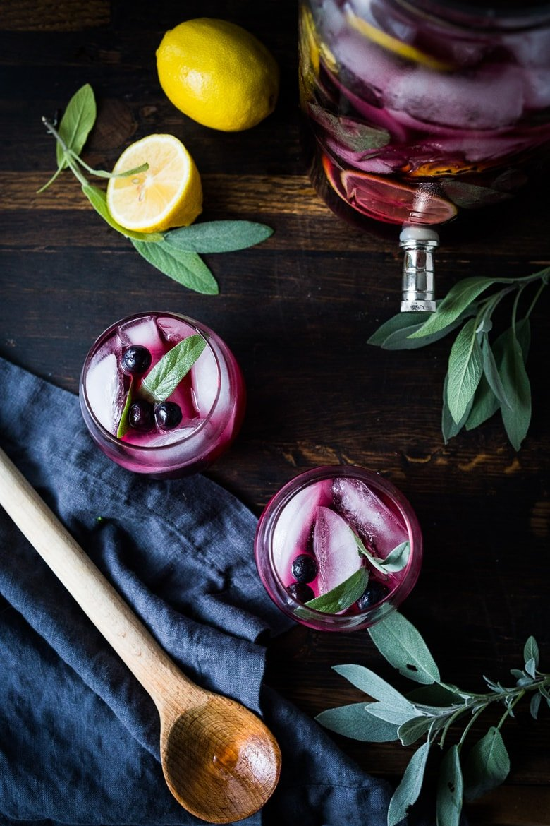 Blueberry Gin and Sage Punch with lemon and prosecco, the perfect make-ahead holiday sparkler. | www.feastingathome.com