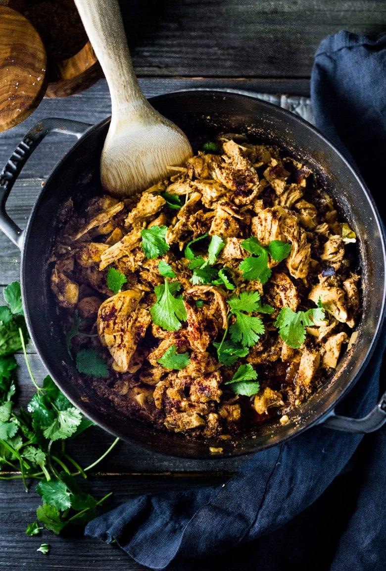 Dutch Oven Chicken Carnitas- make on Sunday, then serve 3 ways during the workweek!   www.feastingathome.com