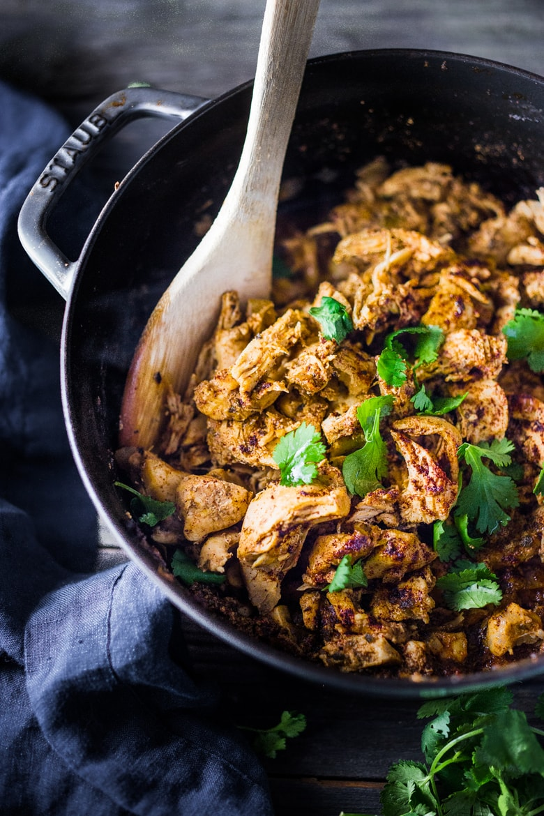 Simple Chicken Carnitas! Make this in an Instant Pot, or on the stovetop or in the oven and use in enchiladas, tacos, burrito bowls during the week. EAsy and delicious!