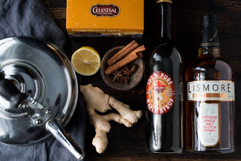 Maple Ginger Hot Toddy- made with whiskey, hot water, muddled ginger, maple or honey, whole spices and a squeeze of lemon- soothes a sore throat and warms the body. | www.feastingathome.com