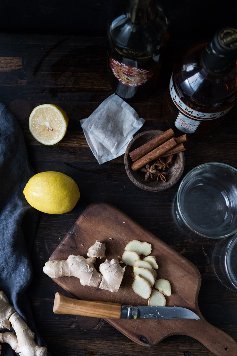 Maple Ginger Hot Toddy- made with whiskey, hot water, muddled ginger, maple or honey, whole spices and a squeeze of lemon- soothes a sore throat and warms the body. | www.feastingathome.commaple-ginger-hot-toddy-103