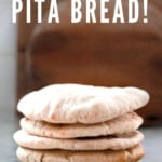How to make fluffy delicious pita bread at home that turns out puffed and golden every time! #pita #pitabread #bread #pitarecipe