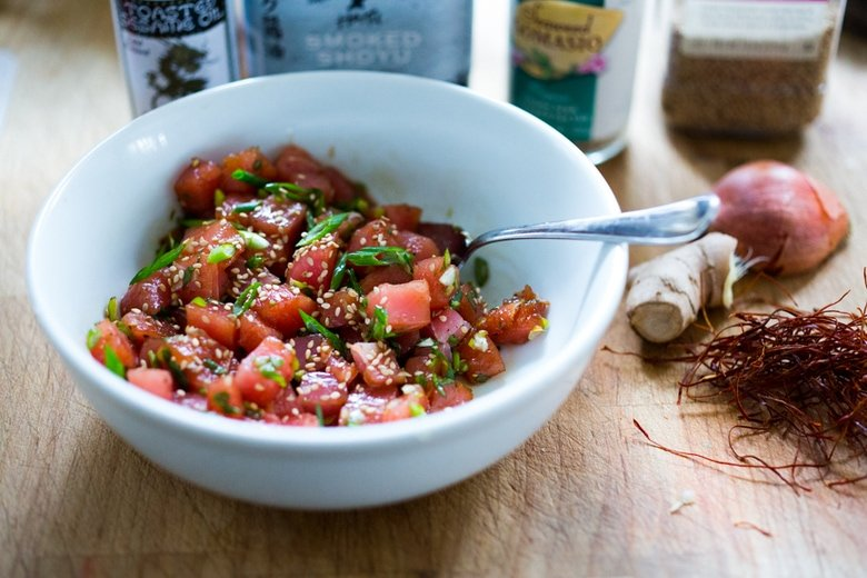 Poke Recipe - made with ahi tuna (or TOFU!) served over brown rice or kelp noodles, with avocado, cucumber, radish and Citrus Ponzu Sauce! | www.feastingathome.com