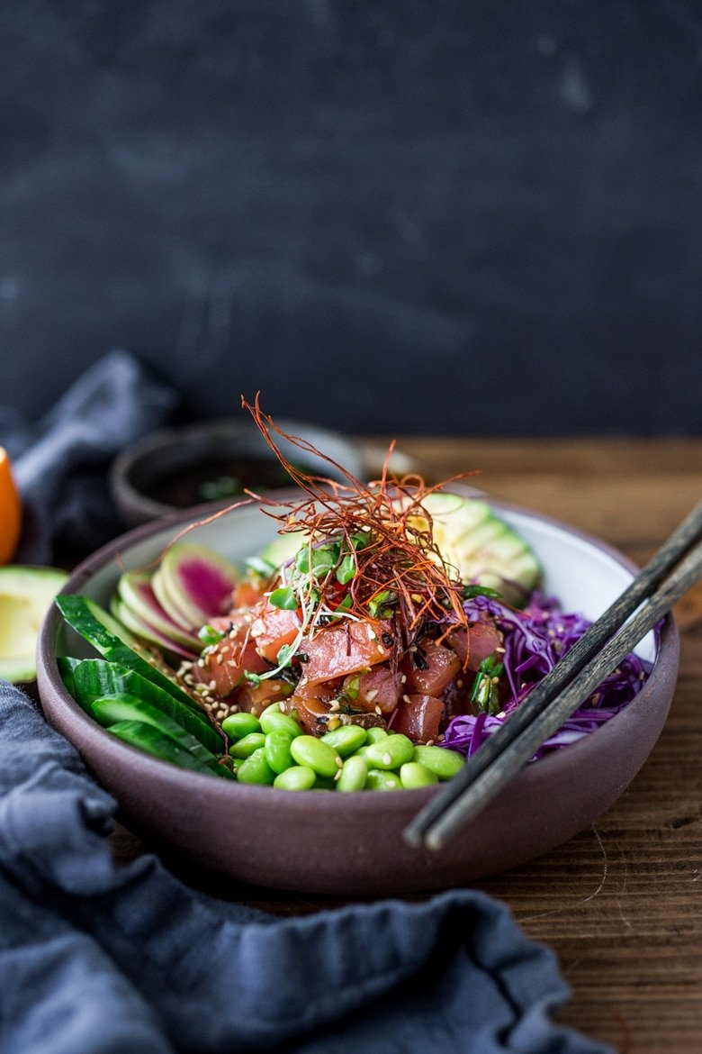 Poke Recipe - made with ahi tuna served over brown rice or kelp noodles, with avocado, cucumber, radish and Citrus Ponzu Sauce! | www.feastingathome.com