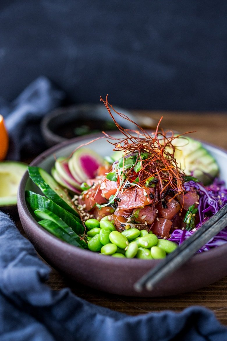 Poke Recipe- made with ahi tuna (or TOFU!) served over brown rice or kelp noodles, with avocado, cucumber, radish and Citrus Ponzu Sauce! | www.feastingathome.com