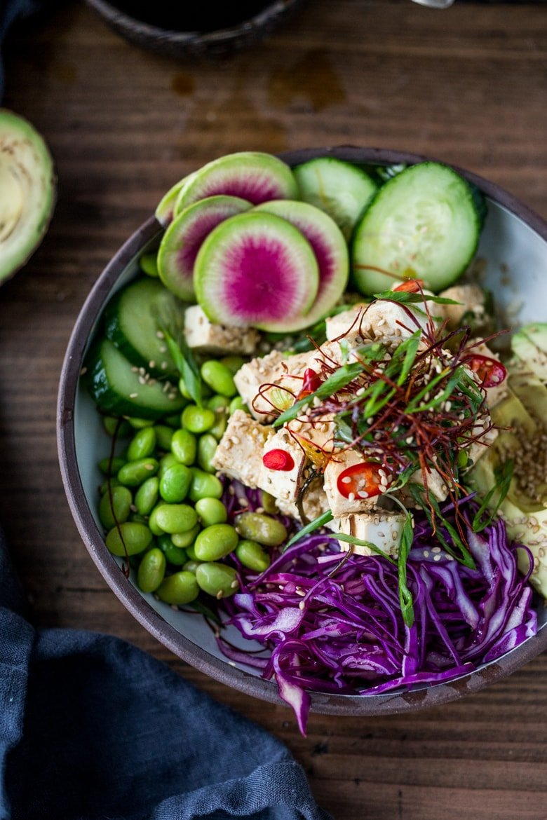 Vegetarian Poke Bowl- made with TOFU! Served over brown rice or kelp noodles, with avocado, cucumber, radish and Citrus Ponzu Sauce! | www.feastingathome.com