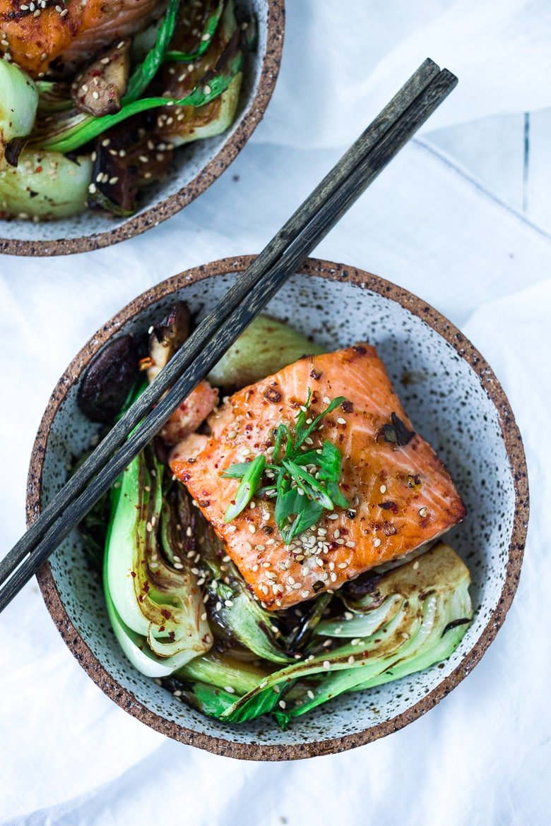 Teriyaki Salmon with Baby Bok Choy- a fast healthy sheet-pan dinner with 15 minutes of hands-on time before baking in the oven -perfect for busy weeknight dinners.  #teriyakisalmon #teriyaki #bakedsalmon #roasted salmon #salmon www.feastingathome.com