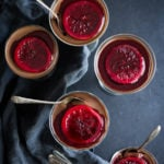 Dark Chocolate Panna Cotta with Blood Oranges- a decadent finish to your special dinner, this creamy luscious dark chocolate dessert is rich and satisfying, yet not overly sweet. Simple to make, this make ahead dessert can be brought out right after dinner, already dished up, with no hassle. | www.feastingathome.com
