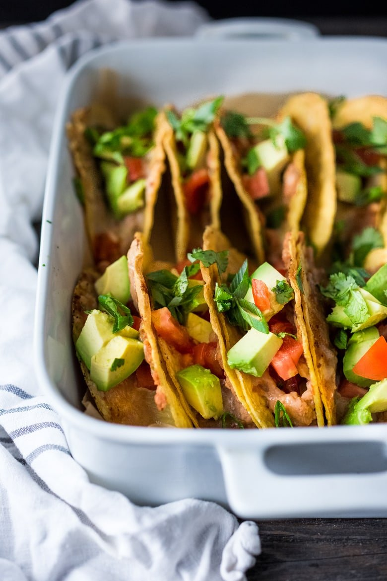 Healthy Baked Vegetarian Tacos - Kid friendly and just 15 minutes of prep before going into the oven to bake. | #tacos #bakedtacos www.feastingathome.com