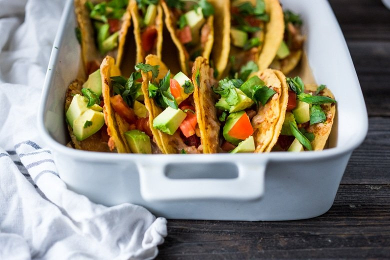 Healthy Baked Vegetarian Tacos - Kid friendly and just 15 minutes of prep before going into the oven to bake. | www.feastingathome.com
