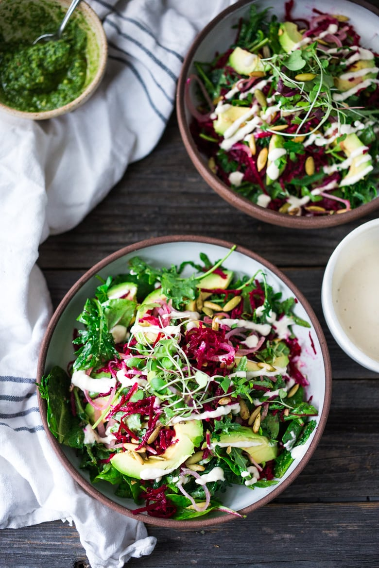 "A raw Beet Salad with avocado, power greens, sprouts, toasted pumpkin seeds, pickled shallots, tossed in a flavorful Cashew Basil dressing and drizzled with Cashew Cream for extra richness. A vegan ""power salad""! #beetsalad #powersalad #vegansalad #veganbeetsalad #raw #rawbeets"