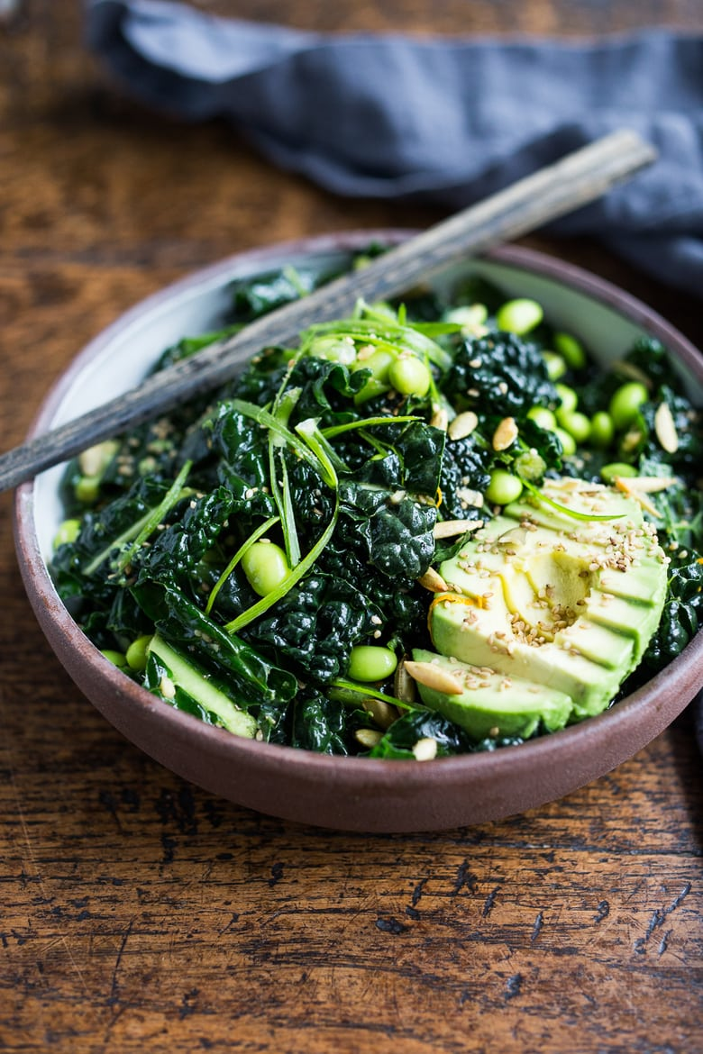 Emerald Kale Salad w/ Sesame Ginger Dressing, Avocado, edamame, scallions, pumpkin seeds and orange zest. Add seared tofu and turn it into dinner! | www.feastingathome.com #vegan #kale #salad #glutenfree