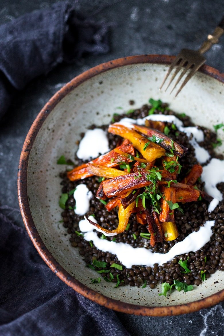 Roasted Moroccan Carrots over seasoned lentils || PLUS 20 simple CLEAN EATING MEALS that are all Plant-Based! | www.feastingathome.com #eatclean #roastedcarrots #veganmeal #veganrecipes #plantbased #cleaneating #eatclean