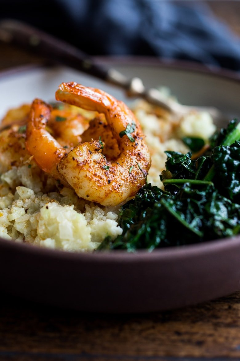 "Portuguese Shrimp and Cauliflower ""Grits""- with garlicky kale. A fast delicious dinner that is vegan adaptable and gluten free! 