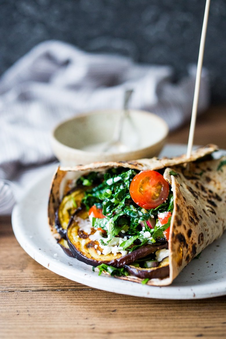 40 Mouthwatering Vegan Dinner Recipes!| Grilled Eggplant Wrap with Kale Slaw and Tahini Sauce | www.feastingathome.com