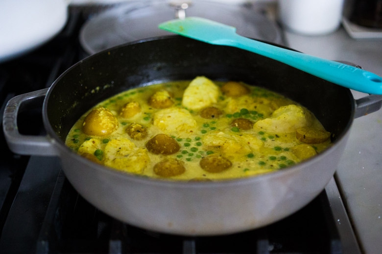 Balinese Fish Curry with potatoes, spring veggies, lime and mint in a fragrant curry sauce.  www.feastingathome.com